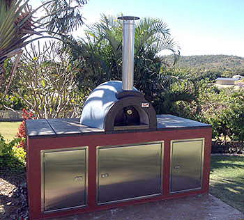 A wood fired oven set in a beautiful tropical garden