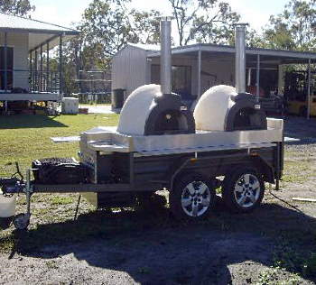 Twin wood fired ovens on a fully equipped tandem trailer
