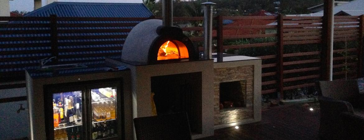 Wood fired oven cooking at night